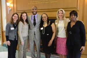 Darian at his installation as the John P. Brennan Chairholder in Classics with his mother, aunt, and Steppingstone staff members
